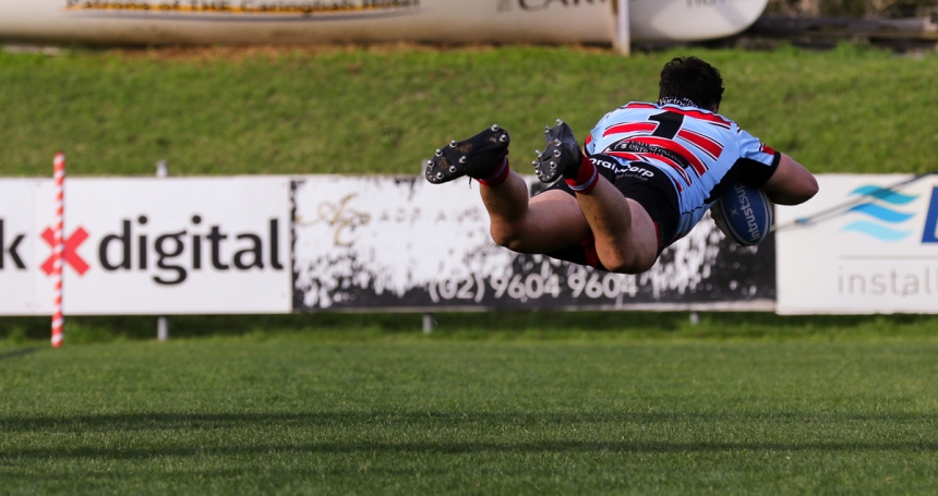 Southern Districts James Wayland flys through the air to score a try!